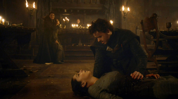 Robb holds his dying wife, while his mother, Catelyn, holds hostage a Frey girl