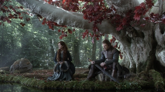 Ned & Catelyn Stark, sitting below a sacred weirwood tree.