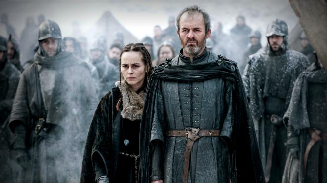 Stannis and his wife look on as their daughter burns